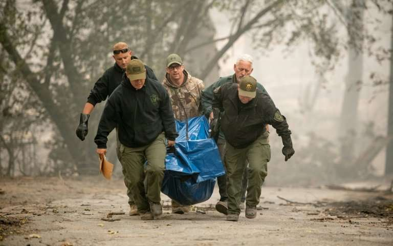 Yuba County Sheriff Officers Carry Body From A Burned Housing From Paradise, California