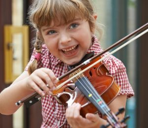 Poor children use learning tools, but school music programs are widely used