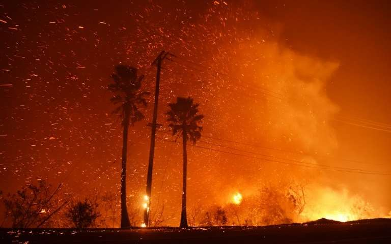 The power line takes up as Woolsey fire burns on both sides of the Pacific Highway (Highway 1) in Malibu, California as